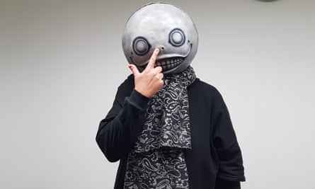 Game developer Yoko Taro in his signature mask.