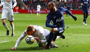 Mike van der Hoorn (left) challenges Tottenham's Lucas Moura in Spurs' 3-0 win at Swansea.