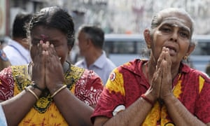 Devotees offer prayers outside St Anthony's church in Colombo
