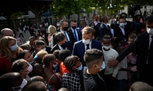 Macron visits Bouge primary school near Marseille.