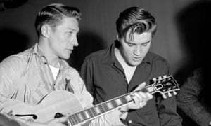 Scotty Moore, left, with Elvis Presley during reheasals for a TV appearance on the Milton Berle Show, 1956.