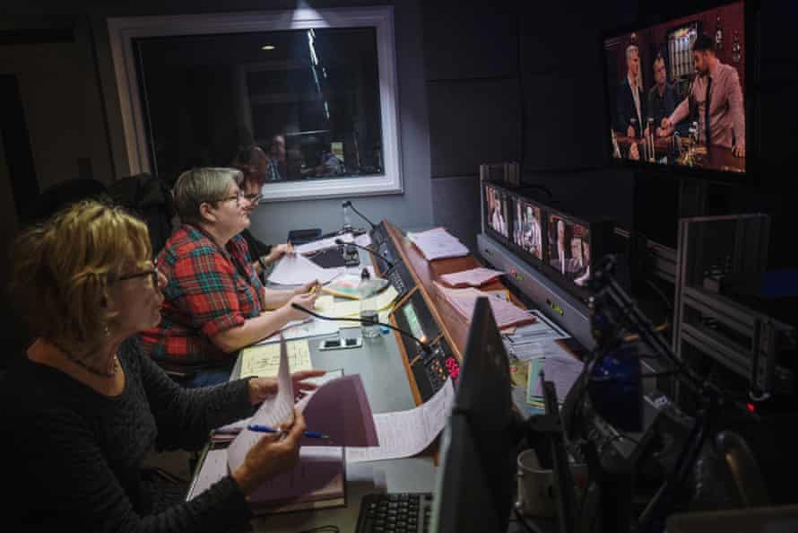 Director Vicky Thomas, centre, watches an episode being recorded