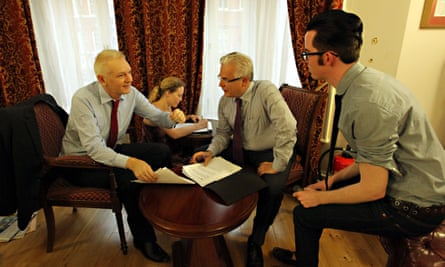 Julian Assange with legal advisers in the Ecuadorian embassy in London