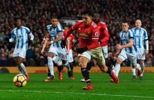 Alexis Sanchez taps in the rebound after his penalty was saved.
