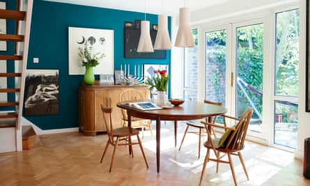 Vintage Ercol chairs surround a G-Plan table, with lights by Secto, from skandium.com.