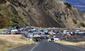 People who are against the construction of a Hawaii telescope block the roadway to the top of Mauna Kea on Thursday.