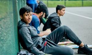 Farouk HussainFarouk Hussain 0129 - on the cricket sidelines: Ali Akbar (foreground), Umar Ghazanfar and Junaid Waris, pupils at Blackburn Central High School