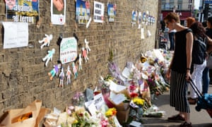 Tributes left near Finsbury Park mosque, north London, after a van was driven into pedestrians.