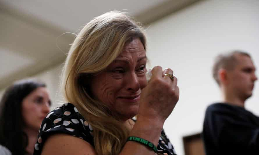 Mary Vega, whose son Alex Vega died in the fire, weeps during a press conference after the trial.