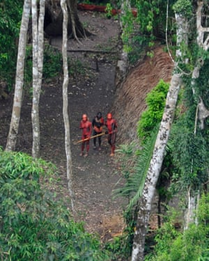A photo made available on 1 February 2011 by Survival International shows members of an uncontacted tribe in the Brazilian Amazon.