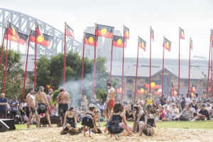 Koomurri dancers perform at a smoking ceremony during the WugulOra morning ceremony at Barangaroo on Sunday.
