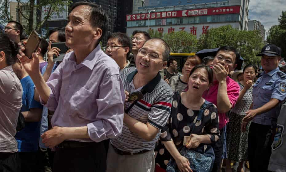 Parents wait for their children to finish taking the gaokao, outside the Beijing Renmin University Affiliated High School, one of the most prestigious in the country.