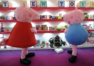 People dressed as cartoon characters Peppa Pig and her brother George
