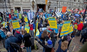 People gathered for a climate change protest in London.