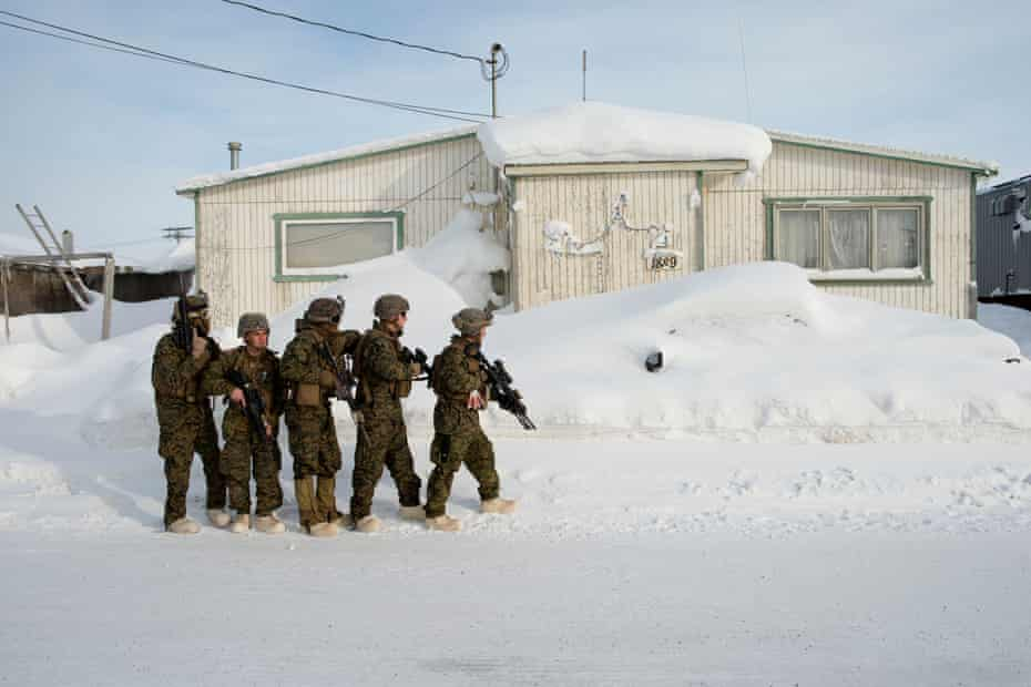 Marines practice room clearing in buildings outside a US National Guard Barracks in Utqiagvik, formerly known as Barrow, in Alaska. These marines were training for operating in cold weather environments and an upcoming deployment to Norway.