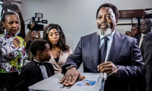 President Joseph Kabila casts his vote along with his family in December 2018.