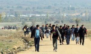 People cross between the Serbia and Macedonia borders