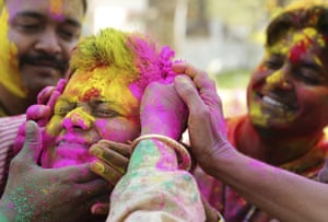 A boy has colours smeared on his face during celebrations in Allahabad, Uttar Pradesh