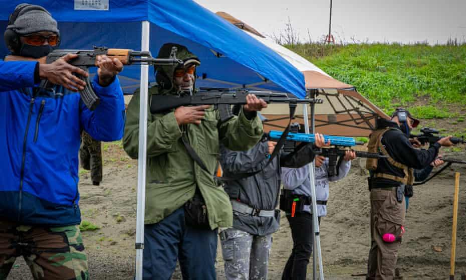 Black novice gun owners line up for a shooting drill during a Black Gun Owners Association training at the Richmond Rod & Gun Club in Richmond, California.