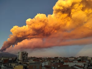 A view of the Mount Etna eruption spewing ash, as seen from Paterno