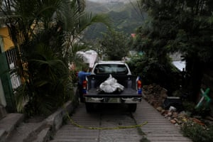 The body of Ronald Blanco lies on a police pick-up in Tegucigalpa