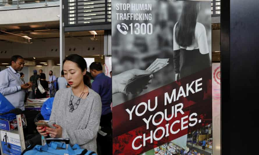 A poster for a Thai government campaign to stop human trafficking is seen in the arrivals hall of Bangkok's Suvarnabhumi airportAC