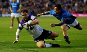 Pete Horne scores Scotland's sixth try despite the attentions of Samoa's Tim Nanai-Williams