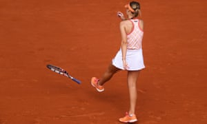 A frustrated Sofia Kenin boots her racquet .