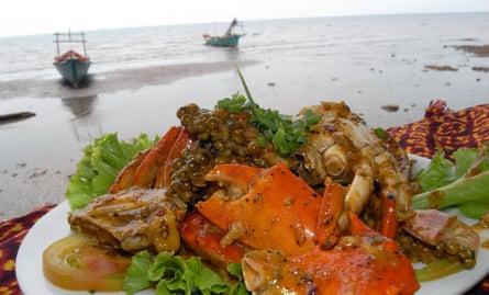 Fresh Kep crab in Kampot pepper on the beach.