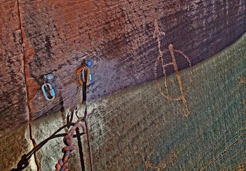 Bolt anchors placed near a petroglyph near Moab, Utah.