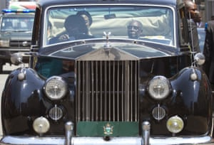 Robert Mugabe travels in the back of a vintage Rolls Royce in Harare, Zimbabwe, for the opening of the last parliament session before next year's elections