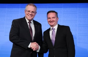 Federal Treasurer Scott Morrison (left) and Shadow Treasurer Chris Bowen shake hands prior to the Treasurers Debate at the National Press Club in Canberra, Friday, May 27, 2016.
