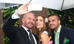 Rachael Finch and Alex Perry pose for a selfie at the Myer Marquee on Melbourne Cup Day