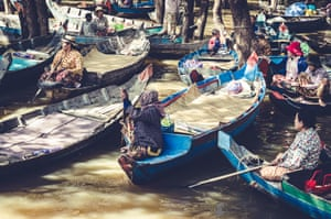 Floating village of Kompong Phluk, Cambodia. The small boats all seemed to be operated by women, some with their children helping out.