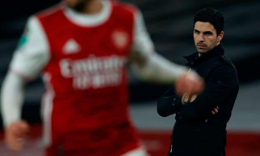 Mikel Arteta looks on as his Arsenal side slip to a 4-1 defeat against Manchester City.
