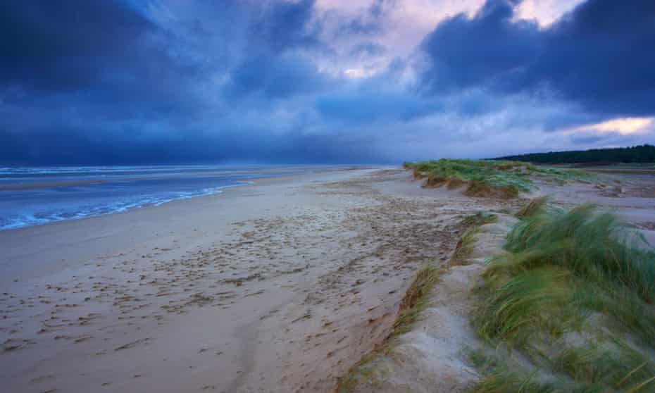 A stormy winter morning at Holkham Bay beach on the North Norfolk Coast.