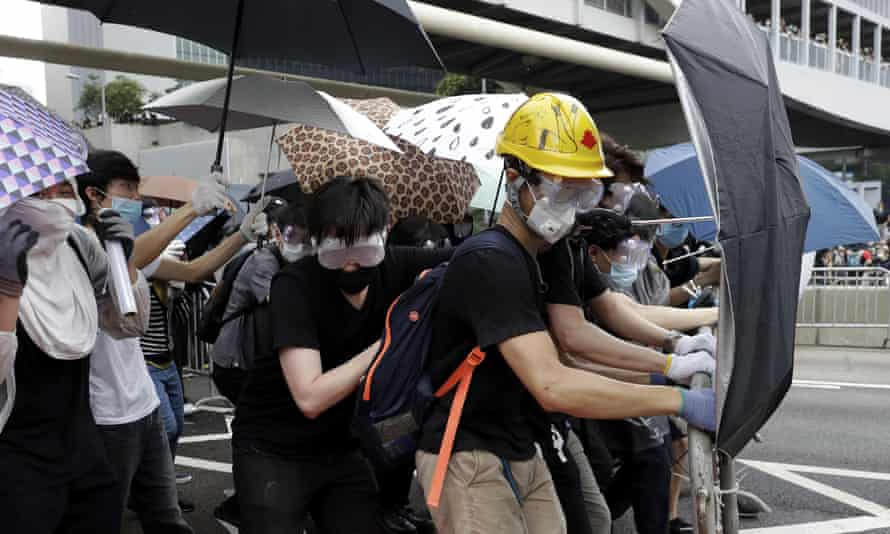 Protestors in Hong Kong shield themselves with umbrellas during demonstrations against the extradition bill.