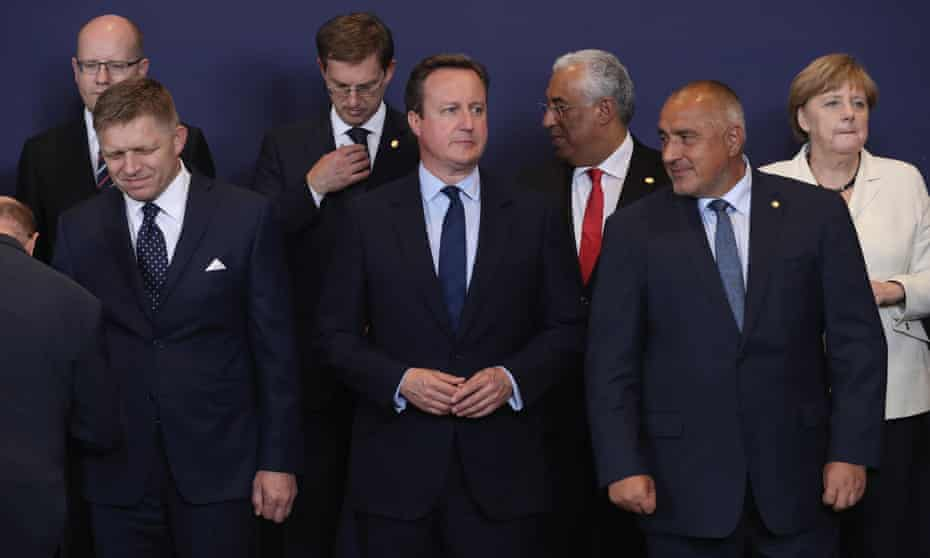 David Cameron waits for the group family photo with the European Council during a European Council Meeting at the Council of the European Union on 28 June 2016 in Brussels.