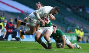 Jonny May of England holds onto the ball despite being tackled by James Lowe to score his first try.