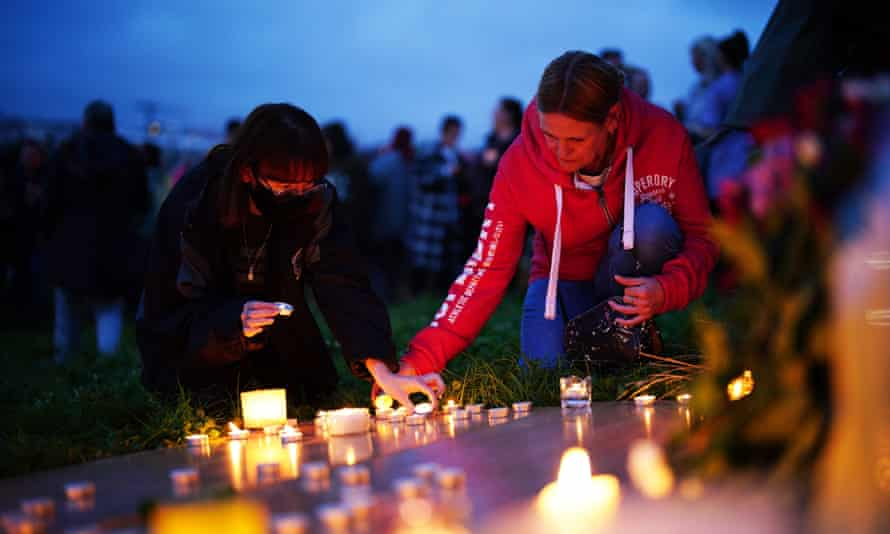Women at a vigil for the victims of the mass shooting in Keyham, Plymouth.