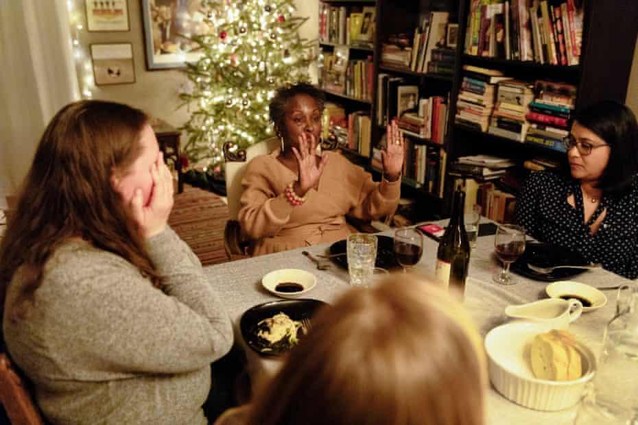 Dinner guests listen to Regina Jackson.
