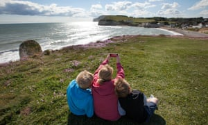 A Family enjoy the view of Freshwater Bay on the Isle of Wight. Image shot 05/2015. Exact date unknown.ERCH7W A Family enjoy the view of Freshwater Bay on the Isle of Wight. Image shot 05/2015. Exact date unknown.