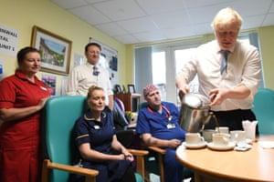 Penzance, UK Boris Johnson has tea with staff members as he visits the west Cornwall community hospital