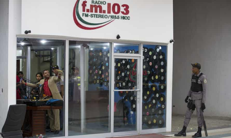Police investigate the facilities of the f.m. 103.5 radio station following the murder of two members of the media, in San Pedro de Macorís, Dominican Republic, on Tuesday.