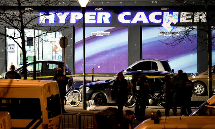 Police officers investigate the scene at the Hyper Cacher kosher supermarket in Paris in 2015.