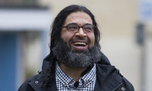 Shaker Aamer, the last UK resident held at Guantánamo Bay, walks along a residential street in London.