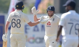 Dan Lawrence and Jonny Bairstow celebrate England's seven wicket victory.
