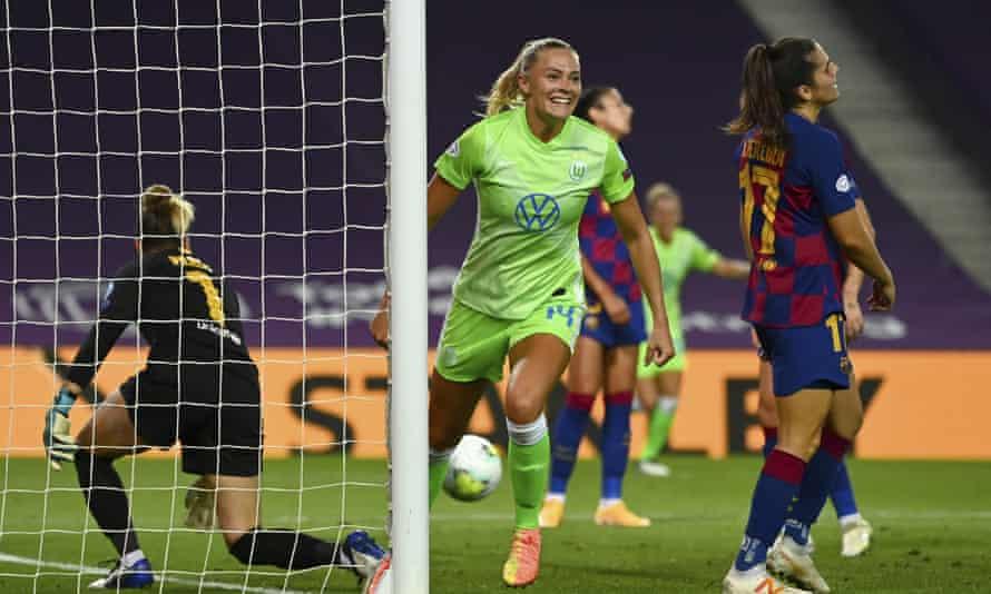Wolfsburg's Fridolina Rolfö celebrates after scoring the winner in the semi-final against Barcelona