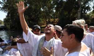 Christian pilgrims from Brazil during a mass baptism ceremony in the waters of the Jordan river – many evangelical groups operate in Israel.