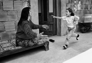 Sedija Katica, who lost both legs after being hit by a grenade, plays with her 5 year old daughter, Amra, near the frontline in Sarajevo